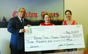 Photo Caption: From left, Times-Kiwanis Camp Fund Chairman Alex Treece accepts a ceremonial check from Jean Gianacaci and Laurie Stewart of the Christine's Hope for Kids Foundation.  Credit: Gaylen Gallimore/For The Times
