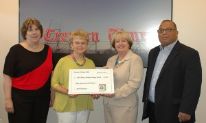 From left, Anne Raughley and Maggie Kramer of the Trenton College Club present a check to Times Publisher and Advertising Director Sheila Gallagher-Montone and Trenton Kiwanis Club President and Camp Fund Chairman Alex Treece. Credit: Gaylen Gallimore/For the Times